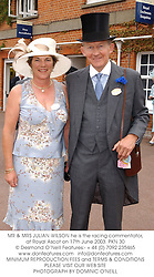 MR & MRS JULIAN WILSON he is the racing commentator, at Royal Ascot on 17th June 2003.PKN 30