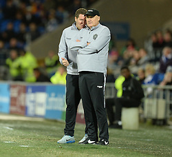 Cardiff City Assistant  Manager, Scott Young Whispers in Cardiff City Manager, Russell Slade ear on the touchline.- Photo mandatory by-line: Alex James/JMP - Mobile: 07966 386802 - 06/12/2014 - SPORT - Football - Cardiff - Cardiff City Stadium  - Cardiff City v Rotherham United  - Football