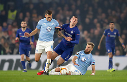 Chelsea's Ross Barkley is tackled buy Malmo's Arnor Ingvi Traustason and Rasmus Bengtsson during the UEFA Europa League round of 32 second leg match at Stamford Bridge, London.