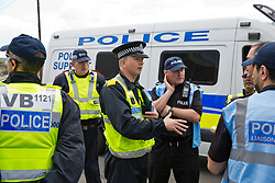 Luton, UK. 27th June, 2015. Police officers on duty for a march by far-right group Britain First and a counter-protest by local residents and anti-racist activists from Unite Against Fascism. A large police presence kept the two groups apart.