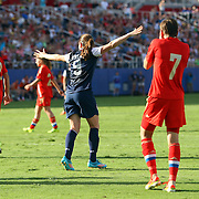 U.S. midfielder Heather O'Reilly (9) celebrates after scoring a goal during an international friendly soccer match between the United States Women's National soccer team and the Russia National soccer team at FAU Stadium on Saturday, February 8, in Boca Raton, Florida. (AP Photo/Alex Menendez)