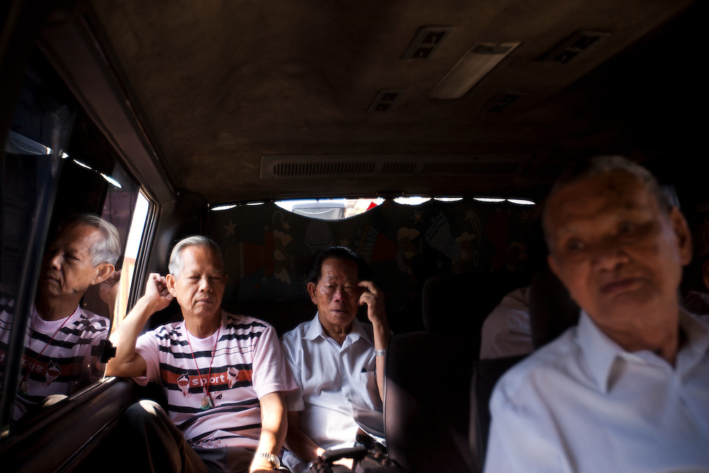 Alfredo Pong Chang, 72, left, rides in a van with friends to watch a tai chi performance at Plaza Vieja,  in Old Havana, Cuba, on Saturday, April 26, 2008. There are less than 400 Chinese-born people living throughout Cuba. .