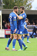 Callum Kennedy of AFC Wimbledon celebrates with Jon Meades of AFC Wimbledon during the The FA Cup match between AFC Wimbledon and Forest Green Rovers at the Cherry Red Records Stadium, Kingston, England on 7 November 2015. Photo by Stuart Butcher.