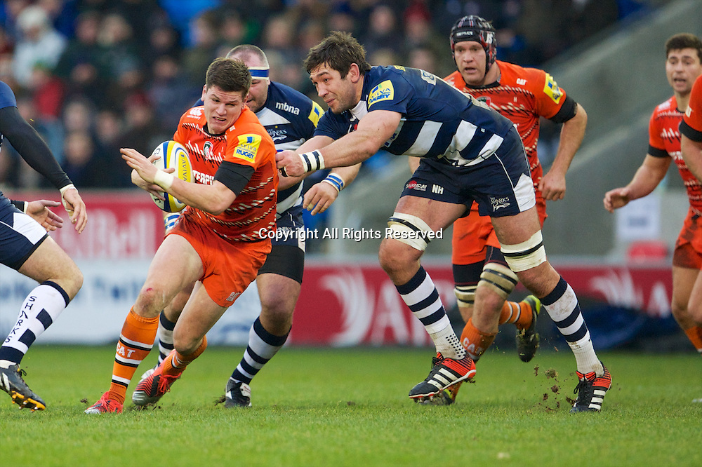 27.12.2014.  Sale, England.  Aviva Premiership. Sale Sharks versus Leicester Tigers. Leicester Tigers fly-half Freddie Burns is tackled by Sale Sharks lock Nathan Hines.