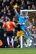 Mark Tyler of Luton Town (right) makes a save under pressure from Sean Jeffers of Newport County (centre) as Steve McNulty of Luton Town  looks on during the Sky Bet League 2 match at Kenilworth Road, Luton<br /> Picture by David Horn/Focus Images Ltd +44 7545 970036<br /> 20/12/2014