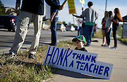 A young protestor holds up a sign referring to a controversy with the local school board in Broomfield, Colorado October 3, 2014. The question of how U.S. teens learn history in public schools is the latest flash point in a liberal-conservative fight over national curricula that had previously focused on more scientific topics such as teaching creationism versus evolution.  REUTERS/Rick Wilking (UNITED STATES)