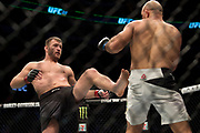 DALLAS, TX - MAY 13:  Stipe Miocic throws a kick against Junior dos Santos during UFC 211 at the American Airlines Center on May 13, 2017 in Dallas, Texas. (Photo by Cooper Neill/Zuffa LLC/Zuffa LLC via Getty Images) *** Local Caption *** Stipe Miocic
