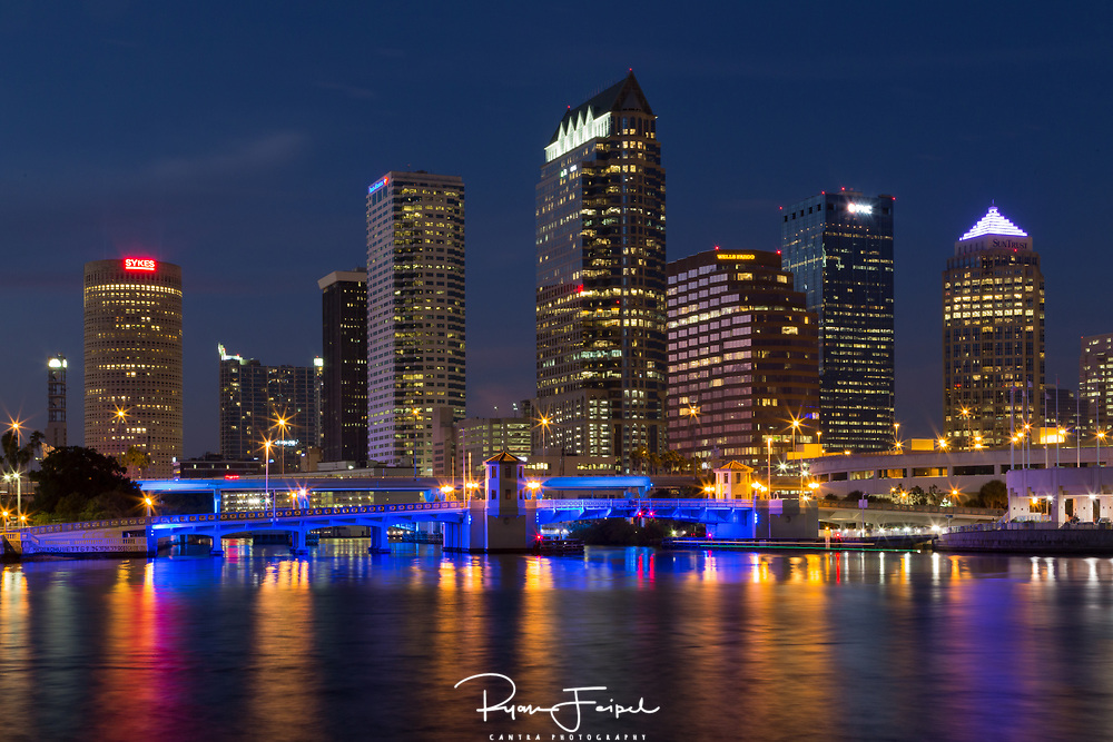 Tampa Bay is a fairly small city but what really drew my interest was the Platt Street Bridge.  It's not a large one by any means.  But you don't find many that change colors every few seconds.  I neglected to bring a tripod for this shot so I improvised.  I found a post, frequented by birds in need of a 'rest', and got the shot.