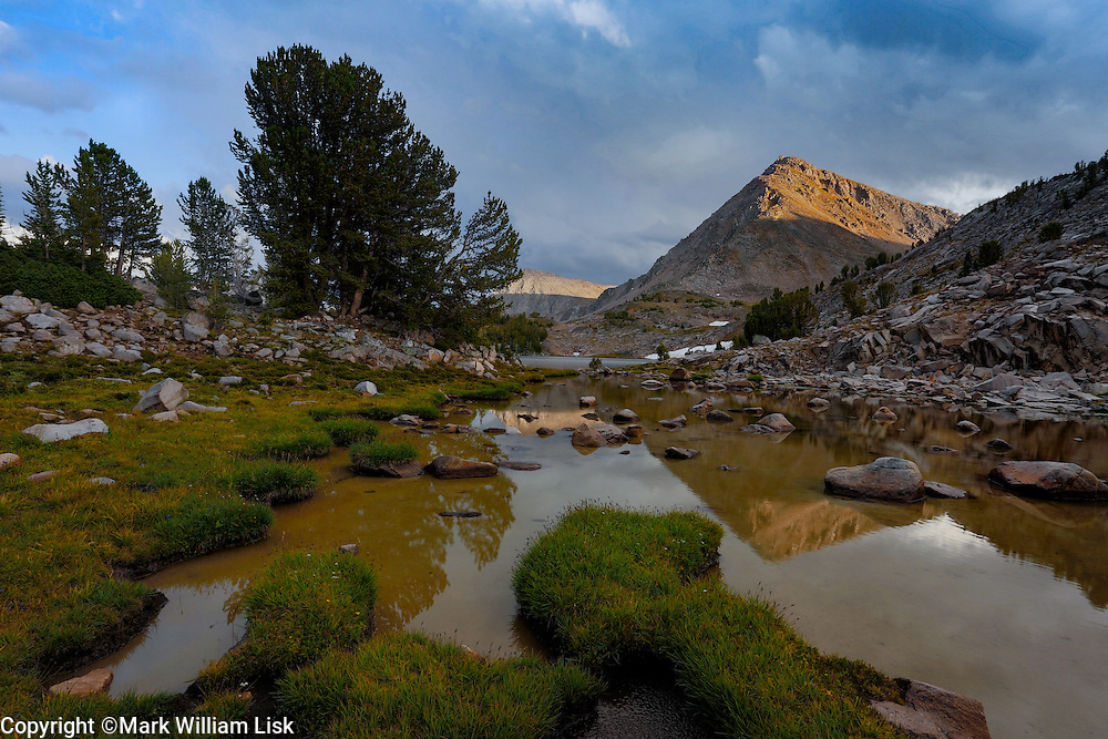 The classic barren peaks of the White Cloud Wilderness tower over Cove Lake in the Big Boulder drainage.