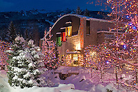Millennium Place, the arts and cultural centre of Whistler Village, BC, sparkles in the evening glow of Christmas lights after a winter snow.