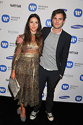 JAMIE DORNAN and ? at the Warner Music Group Post Brit Awards Party in Association with Samsung held at The Savoy, London on 20th February 2013.