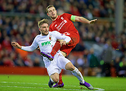 LIVERPOOL, ENGLAND - Thursday, February 25, 2016: Liverpool's captain Jordan Henderson in action against FC Augsburg's Kostas Stafylidis during the UEFA Europa League Round of 32 1st Leg match at Anfield. (Pic by David Rawcliffe/Propaganda)