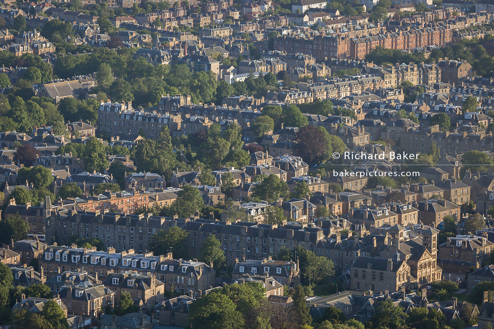 Summer evening sunshine viewpoint from Holyrood Park towards residential streets and rooftops in the Niddrie district of Edinburgh,on 26th June 2019, in Edinburgh, Scotland.