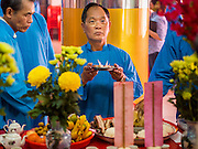 "09 FEBRUARY 2014 - HAT YAI, SONGKHLA, THAILAND: A man prays in the Chao Mae Tubtim Shrine (Ruby Goddess Shrine) on 108 Hainanese Ancestors Memorial Day in Hat Yai, Songkhla, Thailand. Hainanese communities around the world celebrate ""108 Hainanese Ancestors Memorial Day."" The day honors the time when 109 Hainanese villagers fleeing life in Hainan (an island off of the southwest coast of China, near Vietnam) washed up in what is now Vietnam and were killed by Vietnamese authorities because authorities thought they were pirates. The Vietnamese built a temple on the site and named it ""Zhao Yin Ying Lie."" Many Vietnamese fisherman credit prayers at the temple to saving their lives during violent storms and now ""108 Hainanese Ancestors Memorial Day"" is celebrated in Hainanese communities around the world. Hat Yai, the economic center of southern Thailand has a large Hainanese population.    PHOTO BY JACK KURTZ"