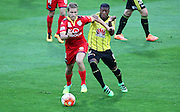 Phoenix' Roly Bonevacia battles for possession wih Adelaide United's Stefan Mauk during the Round 22 A-League football match - Wellington Phoenix V Adelaide United at Westpac Stadium, Wellington. Saturday 5th March 2016. Copyright Photo.: Grant Down / www.photosport.nz