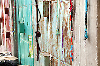 String hanging on a wall in a market of Mombasa, Kenya