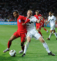 23.06.2010, Nelson Mandela Bay Stadium, Port Elizabeth, RSA, FIFA WM 2010, Slovenia (SLO) and England (ENG), im Bild Ashley Cole of England tangles with Miso Brecko of Slovenia. EXPA Pictures © 2010, PhotoCredit: EXPA/ IPS/ Marc Atkins / SPORTIDA PHOTO AGENCY