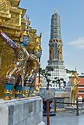 Demons defend a gilded chedi (or stupa) on the grounds of the Temple of the Emerald Buddha (Wat Phra Kaew), protected within the Grand Palace in Bangkok, Thailand, Asia.