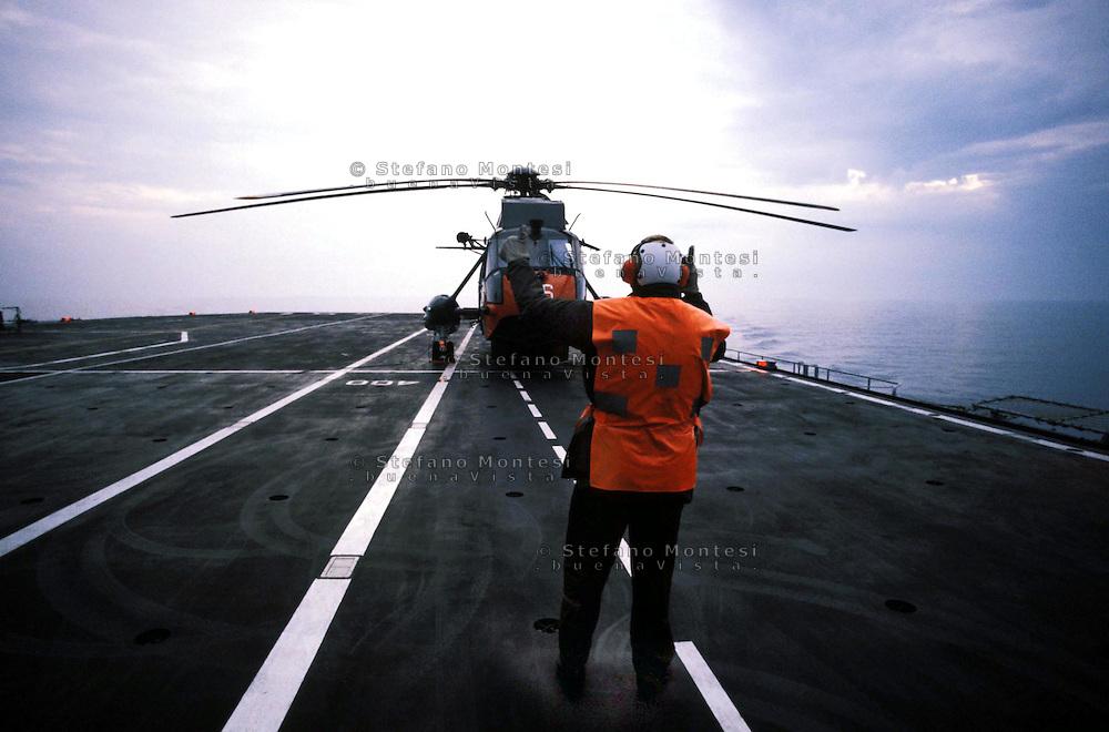 "The Italian aircraft carrier  ""G. Garibaldi""..Antisubmarine helicopters SH-3D in flight night..flight deck staff"
