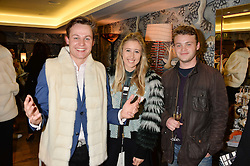 Left to right, ARCHIE MANNERS, AMY FRANCIS and JAKE WILLIS FLEMING at the Mila Furs Trunk Show held at the Haymarket Hotel, 1 Suffolk Place, London on 1st November 2016.