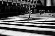 Men trying to escape a striped world at the Santiago Calatrava train hub at the World Trade Center.