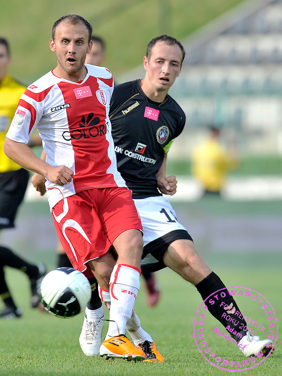 (L) BARTOSZ ROMANCZUK (LKS LODZ) & (R) LUKASZ TRALKA (POLONIA WARSAW) FIGHT FOR THE BALL DURING SOCCER MATCH POLISH T-MOBILE EXTRALEAGUE BETWEEN POLONIA WARSAW AND LKS LODZ IN WARSAW, POLAND...POLAND, WARSAW , AUGUST 13, 2011..( PHOTO BY ADAM NURKIEWICZ / MEDIASPORT )..PICTURE ALSO AVAIBLE IN RAW OR TIFF FORMAT ON SPECIAL REQUEST.