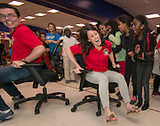 Staff compete in a chair race during a pep rally to energize students for STAAR testing at Garcia Elementary School, March 27, 2014.