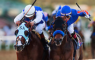 Game on Dude with Chantal Sutherland defeats Setsuko and Victor Espinoza to win the SantaAnita Handicap at Santa Anita Park, Arcadia CA. March 5, 2011. Credit Alex Evers/EquiSport Photos