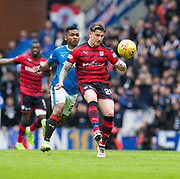 7th April 2018, Ibrox Stadium, Glasgow, Scotland; Scottish Premier League football, Rangers versus Dundee; Josh Meekings of Dundee clears from Alfredo Morelos of Rangers