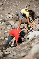 Children sorting rocks, Retalulheu, Guatemala.