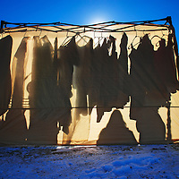 010512  Adron Gardner<br /> <br /> Clothes and customers are silhouetted in a vendor tent at the flea market in Gallup Saturday.