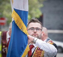 May 4, 2019 - Manchester, United Kingdom - Man seen with a flag during the march..Thousands of people took part in a solidarity march in support for the veterans in Northern Ireland. (Credit Image: © Ioannis Alexopoulos/SOPA Images via ZUMA Wire)