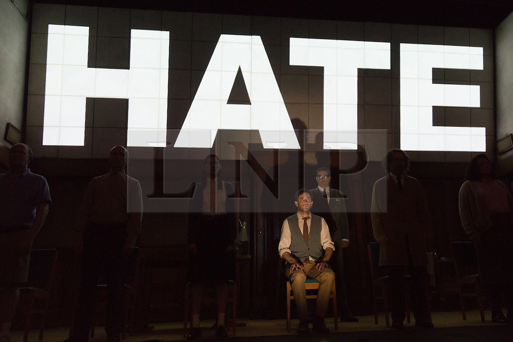 "© Licensed to London News Pictures. 08/05/2014. London, England. Pictured: Sam Crane as Winston and Tim Dutton as O'Brien during the Two Minutes Hate. The Play ""1984"" by George Orwell transfers to the Playhouse Theatre until 19 July 2014. A new adaptation for the stage by Robert Icke and Duncan MacMillan. With Sam Crane as Winston Smith. Photo credit: Bettina Strenske/LNP"