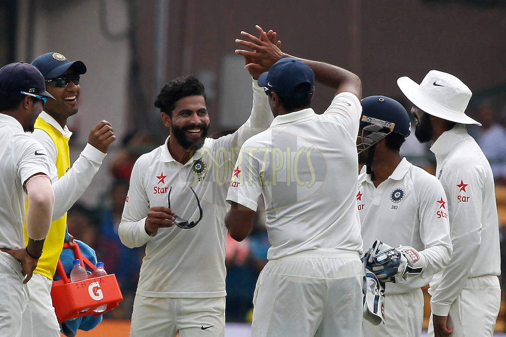 Ravindra Jadeja of India celebrates the wicket of Peter Handscomb of Australia during day two of the second test match between India and Australia held at the M Chinnaswamy Stadium in Bangalore on the 5th March 2017. <br /> <br /> Photo by: Deepak Malik / BCCI/ SPORTZPICS