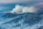 Plumes of smoke rise in the distance showing the northern reaches of the fire. ©2016 Sivani Babu