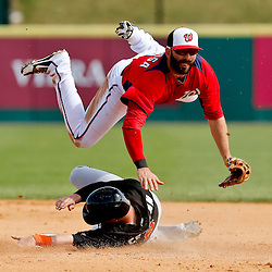 Mar 9, 2013; Melbourne, FL, USA; Miami Marlins left fielder Chris Coghlan (8) upends Washington Nationals second baseman Danny Espinosa (8) while sliding on a double play ground out by Nick Green (not pictured) during the top of the fifth inning of a spring training game at Space Coast Stadium. Mandatory Credit: Derick E. Hingle-USA TODAY Sports