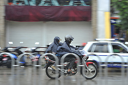 June 20, 2017 - Kiev, NP, Ukraine - Biker travelling towards his destination during sudden rainfall occurs at Kathmandu, Nepal on Tuesday, June 20, 2017. (Credit Image: © Narayan Maharjan/NurPhoto via ZUMA Press)