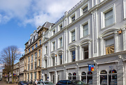 Large nineteenth century buildings being convert to apartments and offices, Butetown, Cardiff Bay, South Wales, UK