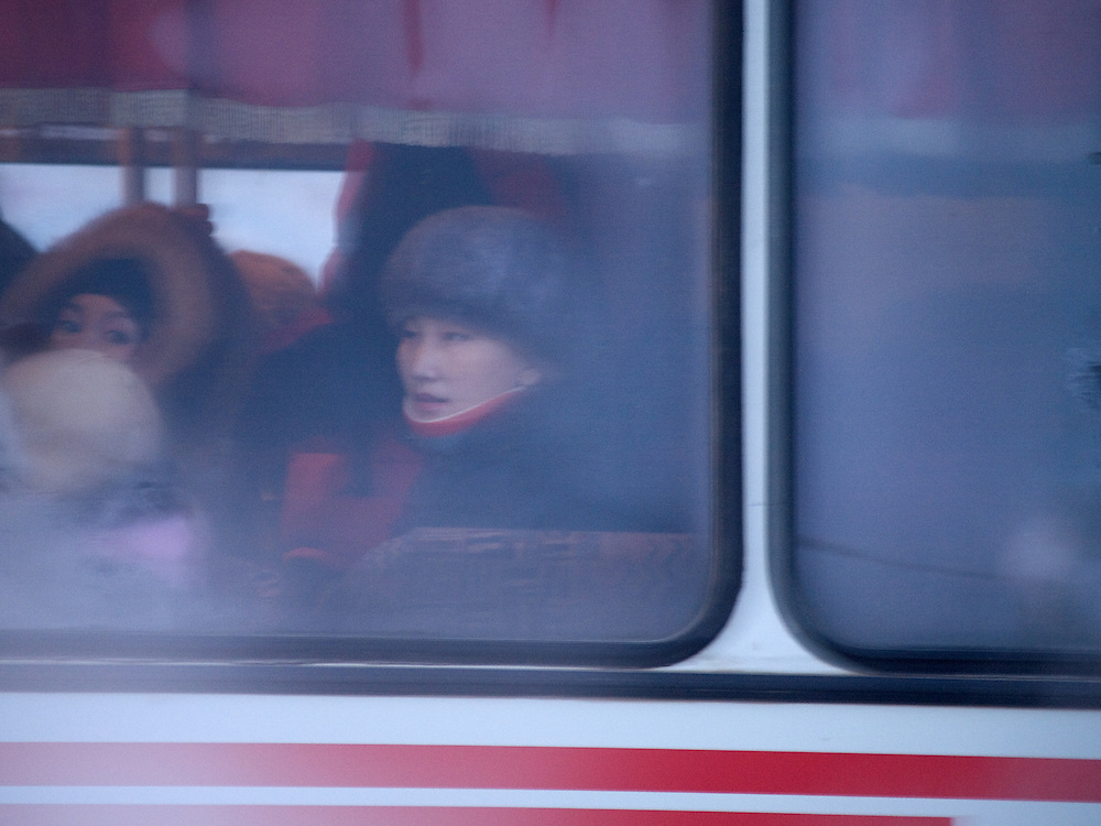 Woman sitting behind a frozen window of a Yakutsk bus. Yakutsk is a city in the Russian Far East, located about 4 degrees (450 km) below the Arctic Circle. It is the capital of the Sakha (Yakutia) Republic (formerly the Yakut Autonomous Soviet Socialist Republic), Russia and a major port on the Lena River. Yakutsk is one of the coldest cities on earth, with winter temperatures averaging -40.9 degrees Celsius.