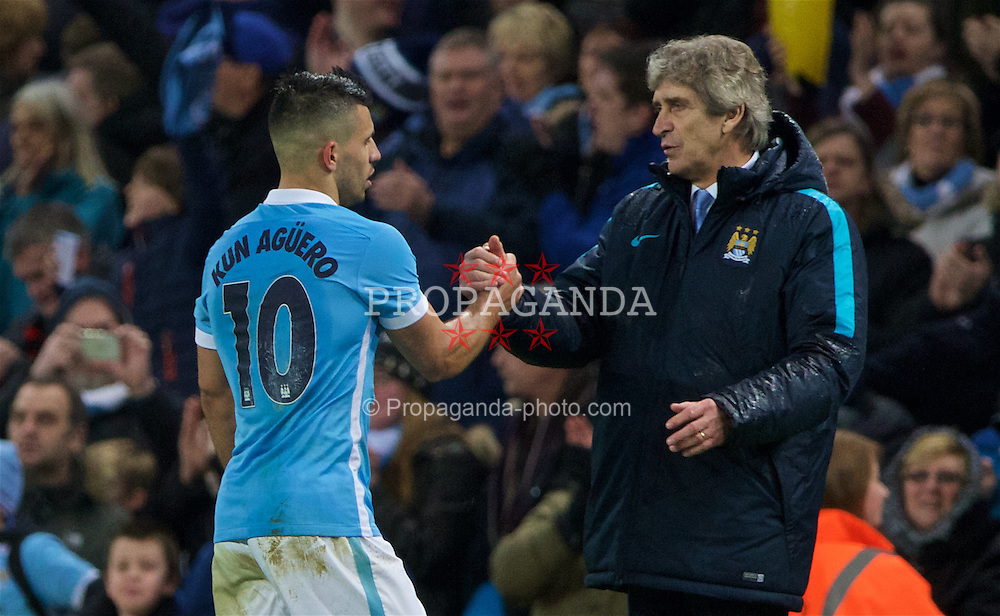 MANCHESTER, ENGLAND - Wednesday, January 27, 2016: Manchester City's manager Manuel Pellegrini congratulates goal-scorer Sergio Aguero after the 3-1 (4-2 on aggregate) victory over Everton during the Football League Cup Semi-Final 2nd Leg match at the City of Manchester Stadium. (Pic by David Rawcliffe/Propaganda)