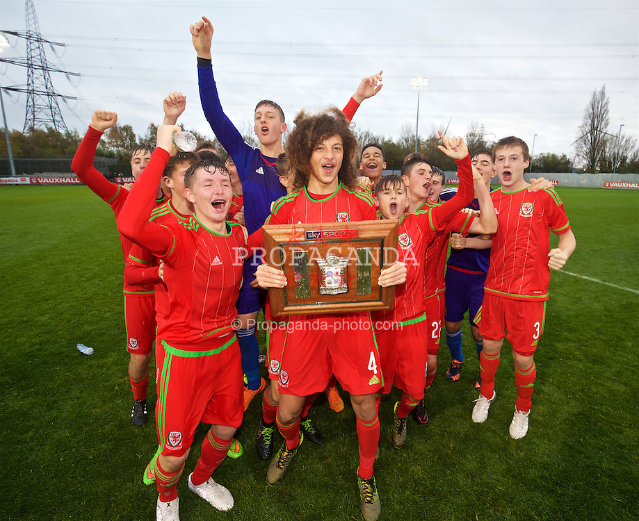 NEWPORT, WALES - Thursday, November 5, 2015: Wales' captain Ethan Ampadu leads the celebrations retaining the Victory Shield following a 3-1 victory over Northern Ireland during the Under-16's Victory Shield International match at Dragon Park. Kieron Holsgrove, goalkeeper Adam Przybeck, Elliot Thorpe, Edward Jones. (Pic by David Rawcliffe/Propaganda)