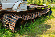 Old rusting Flex-Track truck at Fort Nelson Heritage Museum, 5553 Alaska Highway, Fort Nelson, British Columbia, Canada. This quirky museum features a highway construction display, pioneer artifacts, trapper's cabin, vintage autos & machinery, a white moose, and more.