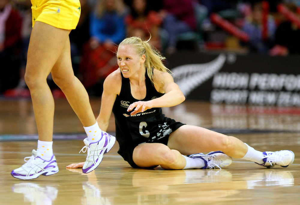 New Zealand's Laura Langman tumbles to the ground in the New World Netball Series match against Australia, SIT Zero Fees Velodrome, Invercargill, New Zealand, Sunday, September 15, 2013. Credit:SNPA / Dianne Manson.