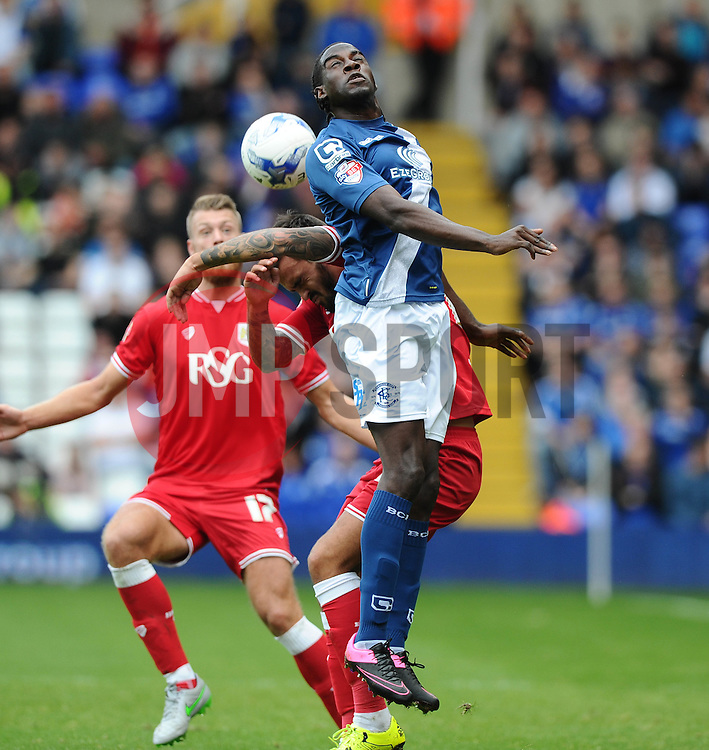 Clayton Donaldson of Birmingham City battles for the high ball with Marlon Pack of Bristol City  - Mandatory byline: Joe Meredith/JMP - 07966386802 - 12/09/2015 - FOOTBALL - St. Andrews Stadium -Birmingham,England - Birmingham City v Bristol City - Sky Bet Championship
