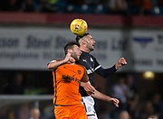 August 9th 2017, Dens Park, Dundee, Scotland; Scottish League Cup Second Round; Dundee versus Dundee United; Dundee's Marcus Haber and Dundee United's Lewis Toshney compete in the air