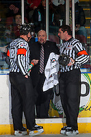 KELOWNA, CANADA - JANUARY 4: Referees Ward Pateman and Mike Langin stand at the penalty box on January 4, 2017 at Prospera Place in Kelowna, British Columbia, Canada.  (Photo by Marissa Baecker/Shoot the Breeze)  *** Local Caption ***