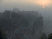 village and medieval castle hiding in a mist France Chateau Landon