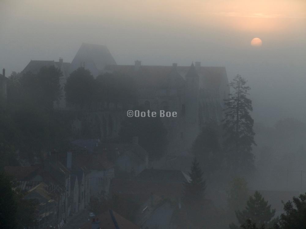 village and medieval castle hiding in a mist France Chateau Landon