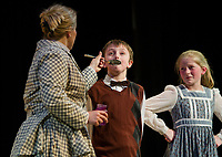 "Kelli Powers as Mary Poppins gives Jesse Powers as Michael ""a teaspoon of sugar to help the medicine go down"" with Isabella Cottrell as Jane during dress rehearsal for The Streetcar producation of ""Mary Poppins"" at InterLakes High School auditorium.  (Karen Bobotas/for the Laconia Daily Sun)"