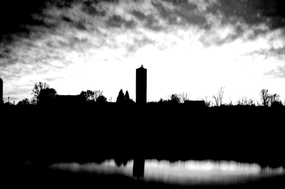 Something about that silo brings to mind a medieval tower. Believe it or not, the reflection isn't a lake, it's from the roof of my Honda.